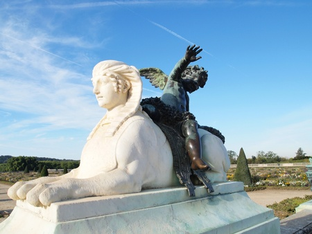 Sphinx and Cupid Statue at Versailles castle in France. photo