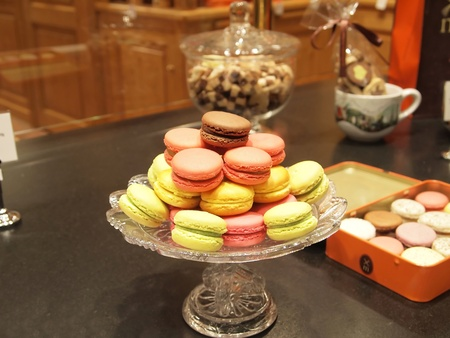 Traditional French dessert. Assortment of multicolored macaroon cookies served on a plate . photo