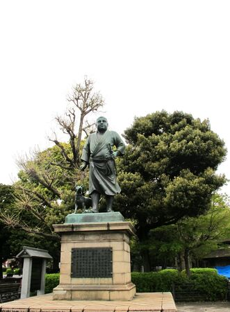Statue in Ueno Park ; A famous bronze statue of Saig? in hunting attire with his dog stands in Ueno Park, Tokyo , Japan. photo