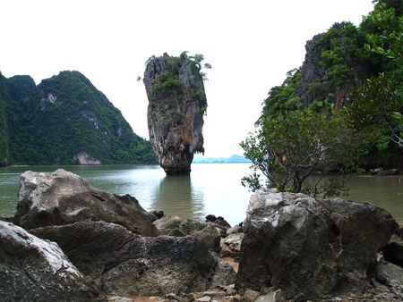 Ko Tapu or Khao Tapu . The island is a part of the Ao Phang Nga National Park. Since 1974, when it was featured in the James Bond movie The Man with the Golden Gun, it is popularly called James Bond Island. photo