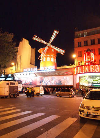 PARIS - September 19: People queue for tickets in front of The Moulin Rouge; famous cabaret and theater on September 19; 2010 in Paris; France.