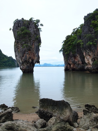 Ko Tapu or Khao Tapu . The island is a part of the Ao Phang Nga National Park. Since 1974, when it was featured in the James Bond movie The Man with the Golden Gun. photo