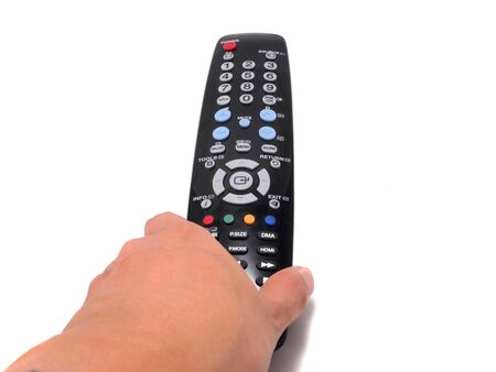Hand holding a Black Remote control with isolated on white . you can use this remote to control whatever you want , Vertical photo