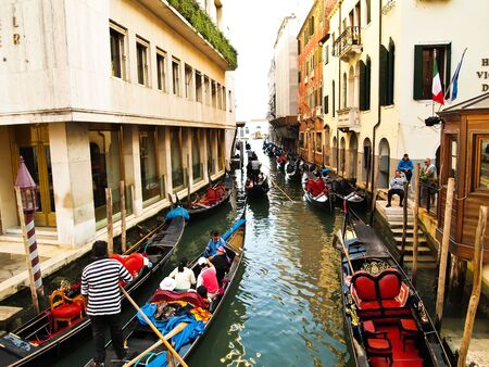 Venice - September 25: Port of Gondoliero sailing in Venice, September 25, 2010, Venice, Italy.  Traditional boats at narrow streets of the italian city. Grand Channel located in Venice - city on Italian islands and is famous for its gondola drivers coord Stock Photo - 9271947