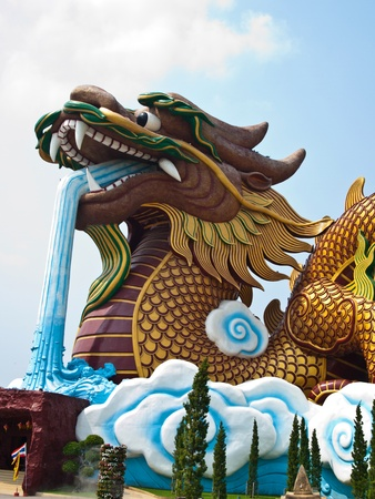 dragon vertical: A Big Crouching dragon at a Chinese style city pillar shrine in Suphan Buri Province , Thailand (Vertical)