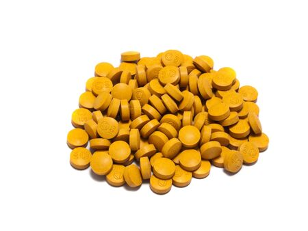 stash: Stash of vitamin C pills against Isolated on a white background