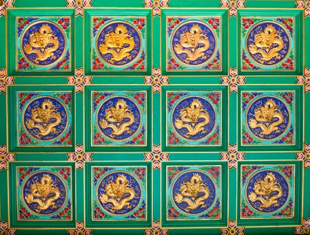 Golden dragons sculpture Wallpaper at chinese temple in Thailand  photo