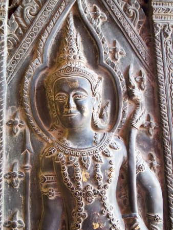 Angel statue at a door in Wat Benjamabopit, Thailand  Stock Photo - 9660934
