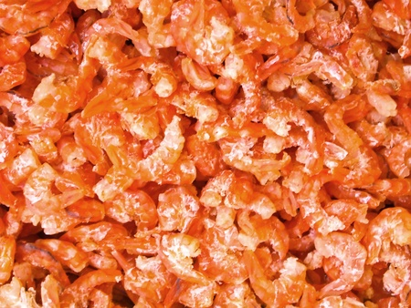 Bunch of dried shrimps backgrounds at almost market in Thailand. photo