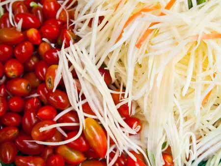 Many Slice papaya and small Tomato for Thai papaya spicy salad or know as Som Tum . photo