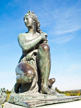 Woman Statue with blue sky at Versailles castle in France , Europe photo
