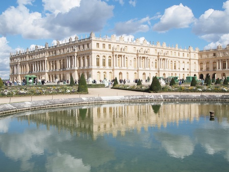 versailles: Castle of Versaille frontage with blue sky in the background and The Shadow image in water , Landscape with Tourism