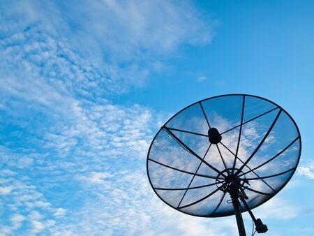 A Satellite communication disk on blue sky background