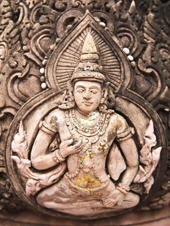 buddhist temple roof: Thai style god (Deva) statue stone sculptures, Bangkok Thailand.  Stock Photo