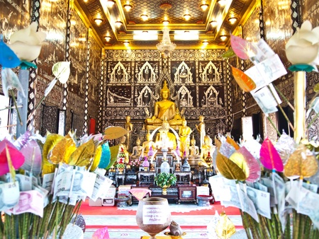 believes: The golden buddha and Money tree at Buddhist temple in Thailand consisting of banknotes donated by visitors for maintenance of the temple