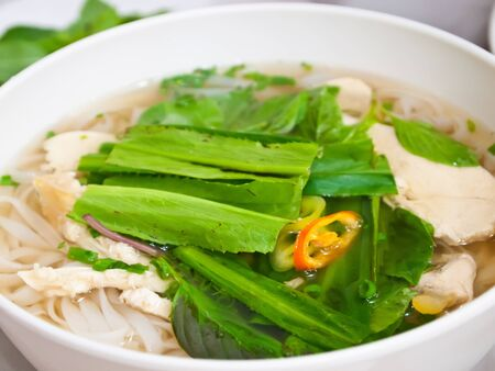 noodle bowl: Vietnamese noodles or Pho , Steamed chicken and vegetable pho Stock Photo
