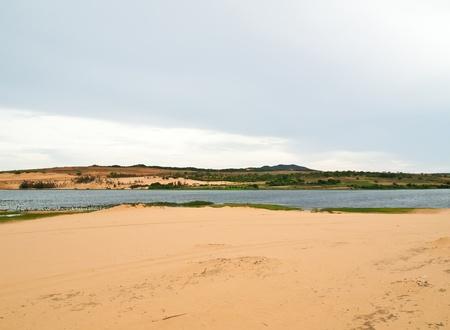 Lake in a white sand dune field near Mui Ne, Vietnam  photo