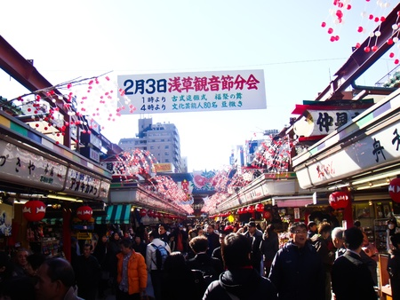 TOKYO, JAPAN - February 1: People floating to Asakusa Temple through Nakamise Street ,on February 1, 2009 in Tokyo, Japan.