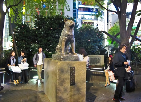 adjacent: Hachiko ,a dog statue who waited on his late master at Shibuya Station at Hachiko Square is the most popular meeting point in Shibuya , Tokyo Japan Editorial