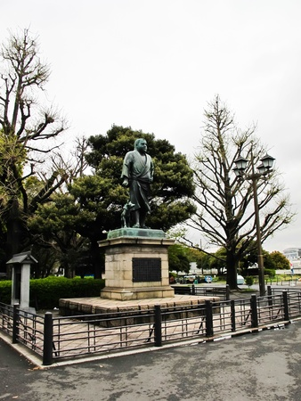Statue in Ueno Park ; A famous bronze statue of Saigo in hunting attire with his dog stands in Ueno Park, Tokyo , Japan. photo