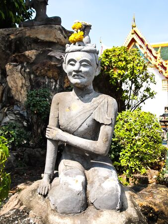 Ascetic statue at wat pho temple in Bangkok , Thailand photo