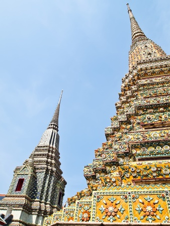 historical sites: Ancient pagoda at Wat Phra Chetuphon Vimolmangklararm , Wat Pho, the oldest historical sites in Bangkok , Thailand and that Thailands tourism  Stock Photo