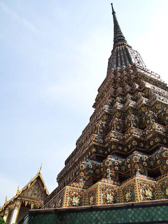 Ancient stupa with Wat Phra Chetuphon Vimolmangklararm on the background , Wat Pho, the oldest historical sites in Bangkok , Thailand and that Thailands tourism photo