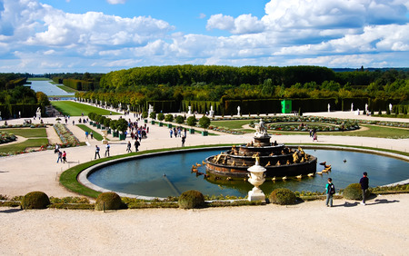 Versailles Castle gardens with fountain   tourists  background bright blue sky at Versailles in France  , Photo on 17 September 2010