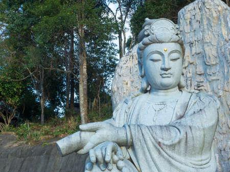 Stone carving of Guanyin. kuan-eim. kuan-yin.