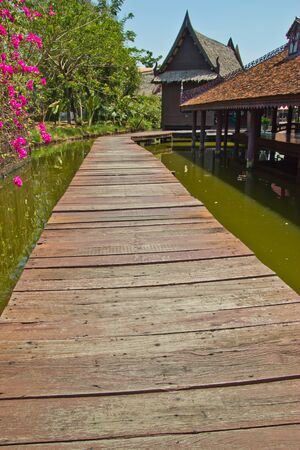 wood bridge , at use the footpath goes to still the floating market , photo