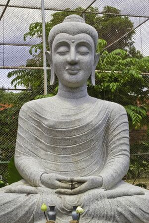righteous: image of stone granite Buddha , at righteous temple , Cholburi , Stock Photo