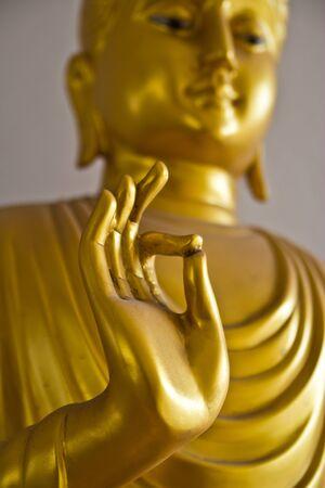 Buddha gold statue close-up photo