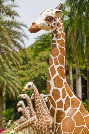molded: molded figure giraffe  in a garden