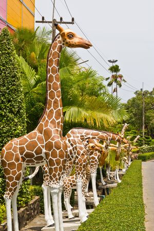 molded figure giraffe  in a garden photo