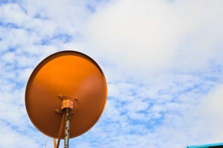 red dish antennas with blue sky photo
