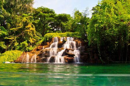 turbid: a waterfall models in the public park at thailand Stock Photo