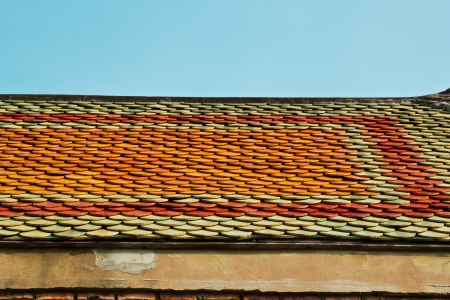 Red tiles roof and blue sky background photo