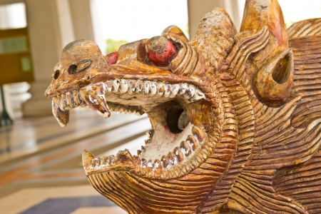 Wood carving of a dragon at thailand Stock Photo - 16417187