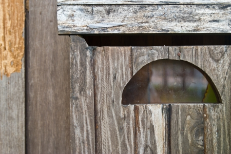 Vintage grungy letter box on wooden door photo