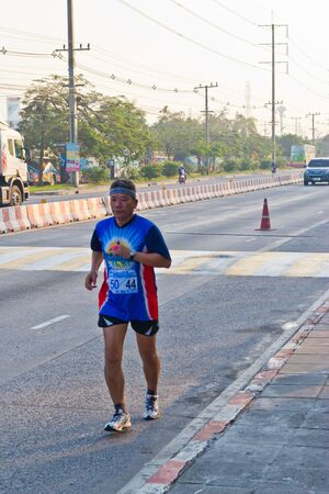 CHONBURI, THAILAND - DESEMBER 16  Unidentified runner competes on the street during Standard Charterd amata mini Marathon 2012 running championship on desember 16, 2012 in chonburi, Thailand