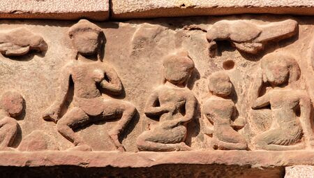 lintel: Ancient Khmer lintel carved with a kala demon figure sitting on top of two Makaras, sea serpents. Ornate bas relief on part of Banteay Srei temple, Angkor, Cambodia.
