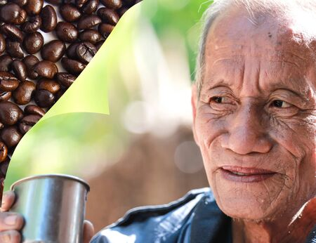 an aged cheerful old man holding a cup of coffee Stock Photo - 17501991