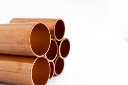 diameter: set of copper pipes of different diameter lying in one heap