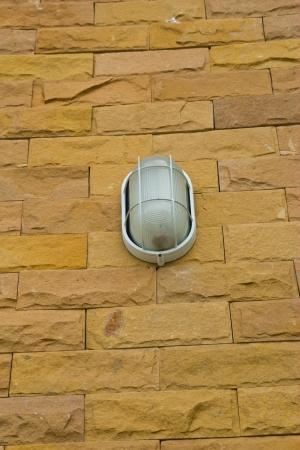 lamp on stone wall background photo