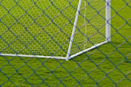 goalpost net detail with green grass blur in background sports concepts photo