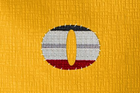 The letter O on cloth