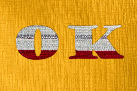 The letter OK on cloth photo
