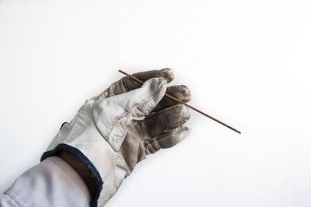 leather glove catches cable wire Stock Photo - 18338255