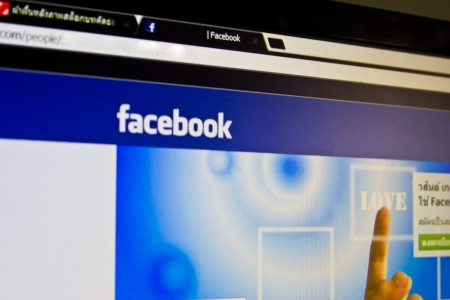 Thailand -24 is February  : face book be community network that a Thai likes to play last highly since  a child until old people is a place where has narcotic trading until every kind goods , at 24 February 2013 Thailand Stock Photo - 18831914