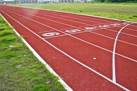 red running tracks in sport stadium Stock Photo